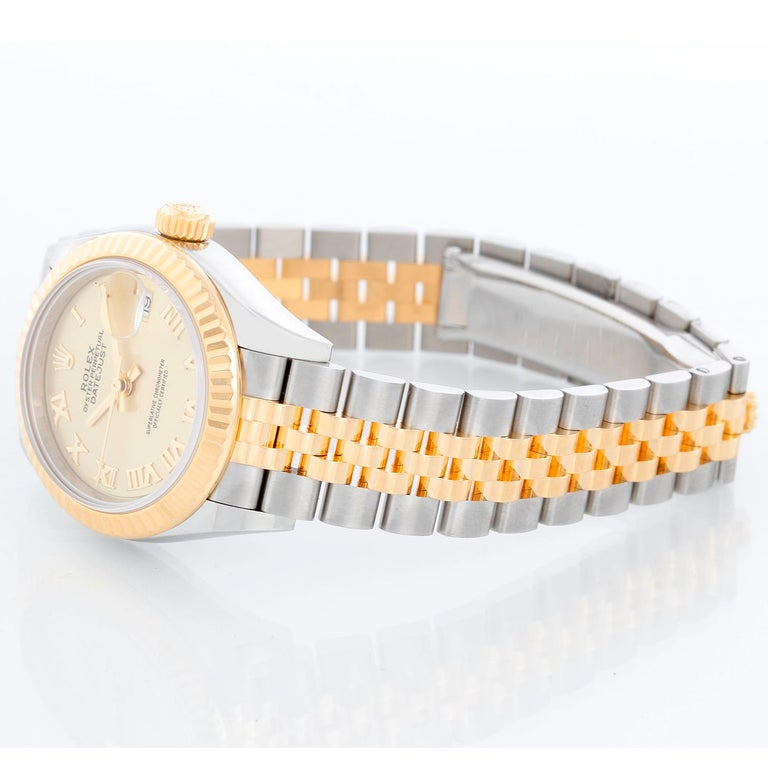 Ladies Rolex Datejust 28mm 18K Yellow Gold and Stainless Steel 279173 - Automatic winding, 31 jewels, Quickset date, sapphire crystal. 18K Yellow gold and Stainless Steel ( 28 mm). Champagne Roman dial. Two-Tone Jubilee bracelet. Pre-owned with
