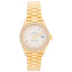 Ladies Rolex President 18 Karat Yellow Gold Diamond Watch 79138
