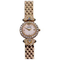 Ladies Tourneau Gold Watch with Diamonds Sapphires and Mother of Pearl Dial