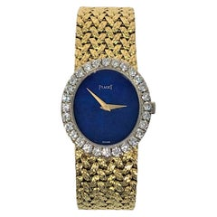 Ladies Vertical Oval Lapis Dial Diamond Bezel Yellow Gold Piaget Watch