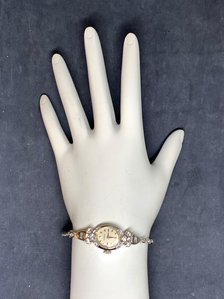 Rare Ladies Collectable OMEGA 14k White Gold with approximately 1.25 carat of Natural Diamond Manual Wind Cocktail Watch.   It is set with 34 natural colorless diamonds weighing approximately 1.25 carats, the watch itself weighs 14.34 grams and is