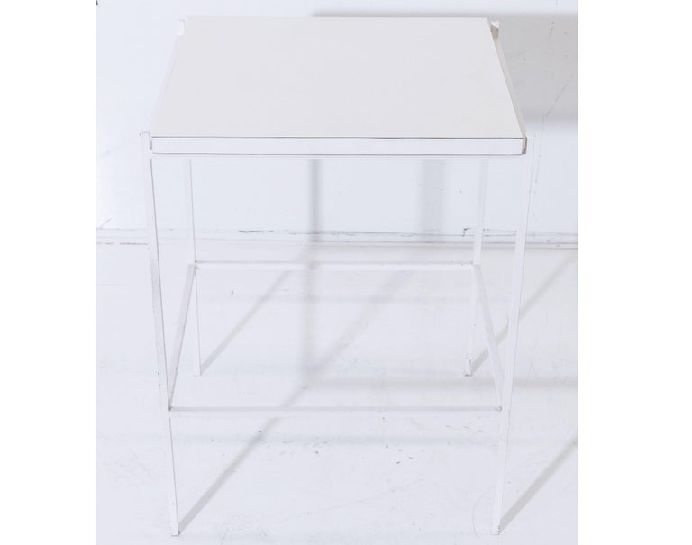 Ladislav Rado white enameled steel modern side table, 1955, Knoll and Drake.  Knoll and Drake produced a signature modern line of furniture for a few short years which had enameled square painted tube for its structural elements and was designed