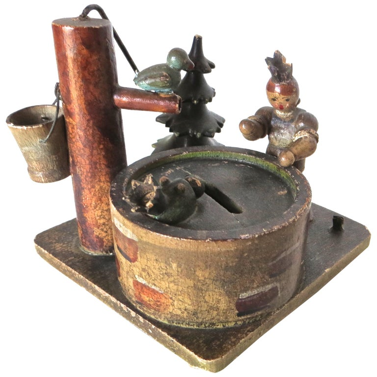 """""""Lady and Baby by The Wishing Well"""" Still Bank, German, circa 1910 For Sale"""