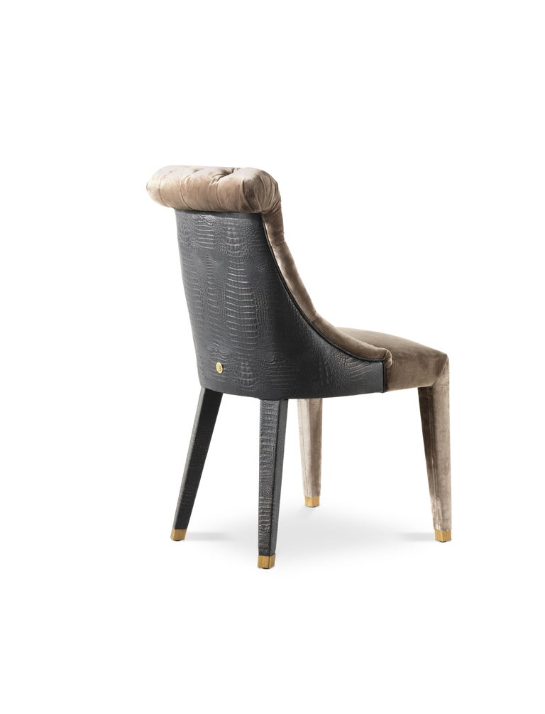 Chair structure in beech wood and foam. Back upholstery in leather CAT. B cocco COL. 5. Front upholstery in fabric CAT C velvet Harrison COL.10 brown. Tips in brass brushed gold finishing.