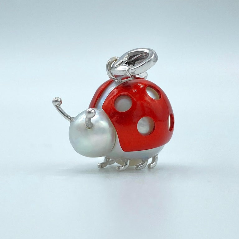 Ladybug/Ladybird 18 Kt Red White Gold Australian Pearl Pendant Necklace Made in Italy  This peculiarly shaped pearl reminded me of the cute ladybugs from a cartoon. So I enjoyed making this pendant: I used white gold for the antennas and the charm,