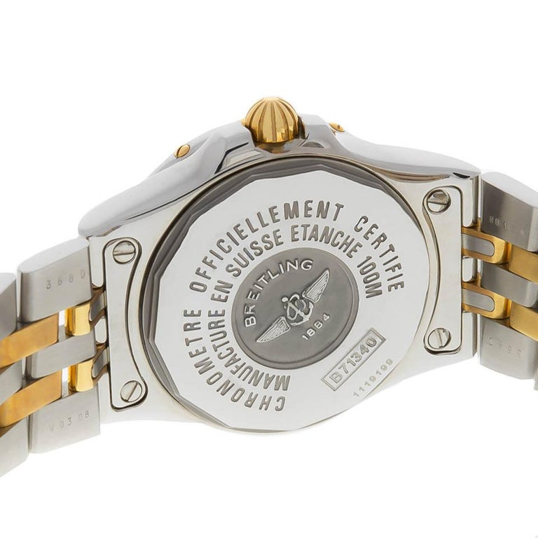 Lady's Breitling Starliner steel and 18K with Mother of Pearl diamond dial and steel and 18K pilot bracelet. New,  in original box. Style B71340 Serial 1119199
