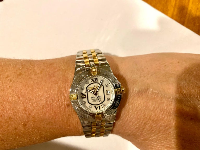 Ladies Breitling Mother of Pearl Diamond Dial Steel and 18 Karat Pilot Bracelet In New Condition For Sale In Spartanburg, SC