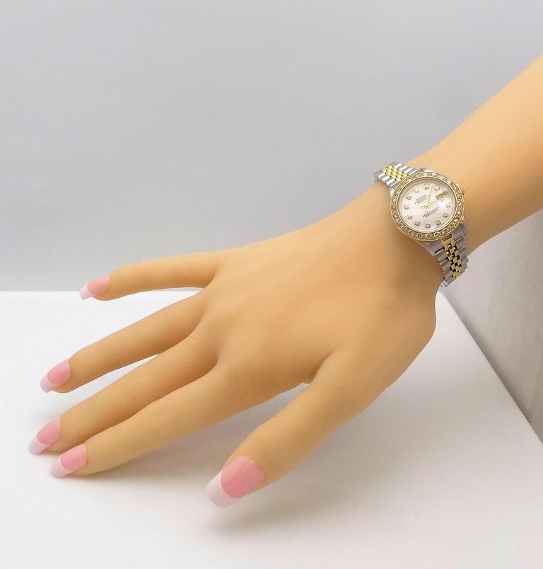 Lady's Diamond Rolex Wrist Watch with Mother-of-Pearl Dial In Good Condition For Sale In Dallas, TX