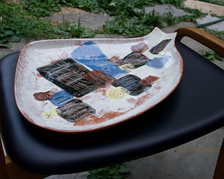 Wonderful and huge party plate or shallow dish by the Southern California master, hand signed.