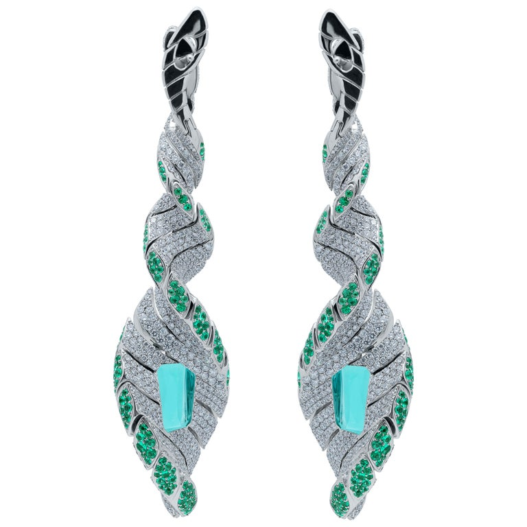 Tourmaline Diamonds Emeralds 18 Karat White Gold DNA Earrings In the shape of these Earrings, you probably already guessed that when they were created, our designers were inspired by the structure of human DNA. What could be more perfect? But not