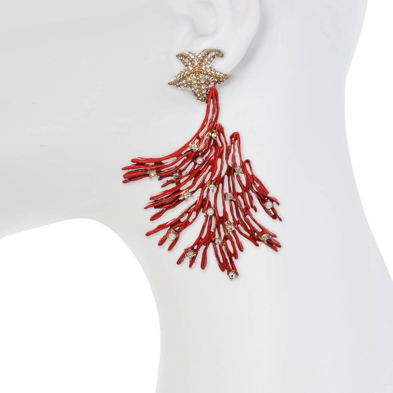 "Living in Gold & Red!   ""Laguna"" is an Italian name meaning ""A body of water cut off from a larger body by a reef of sand or coral"", perfectly suits  this gorgeous pair of statement earrings. Wear your hair up in an elegant style and make a"