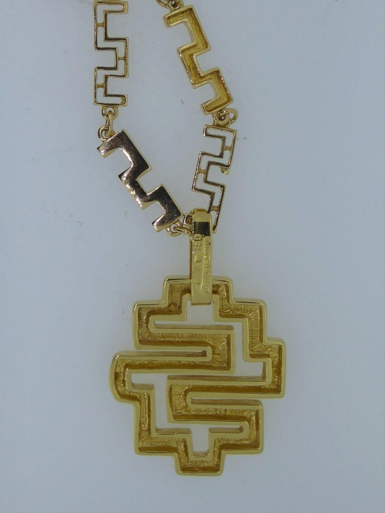A Lalaounis 18 Carat Yellow Gold Geometric Link Labyrinth Pendant Necklace. Circa 1990s. The geometric gold links suspending a detachable labyrinth pendant. Stamped