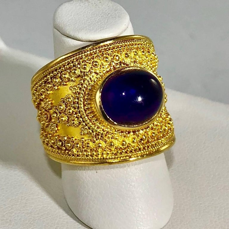 Oval Cut Lalaounis 18 Karat Cabochon Amethyst Vintage Cocktail Ring, circa 1960 For Sale