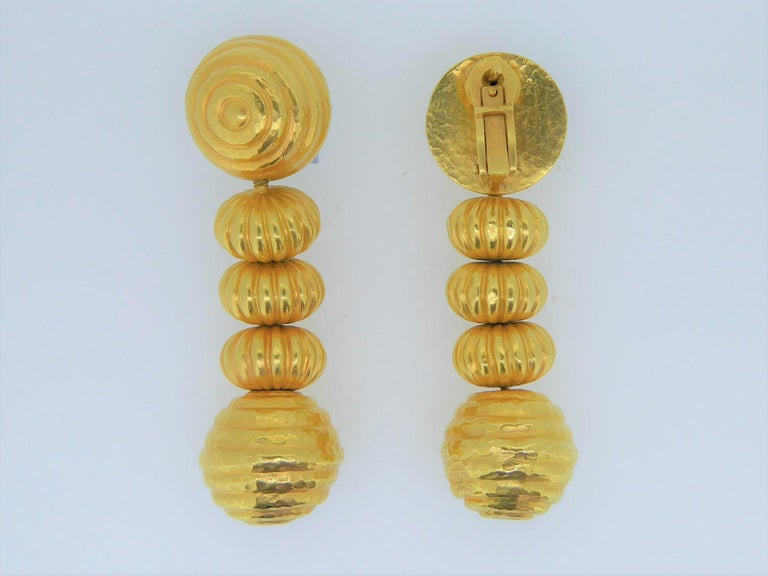 A Lalaounis 22 Carat Yellow Gold Minoan Bead Pendent Earrings. Circa 1970s. The 22ct hammered yellow gold bead earrings, each with removable drops. All on a beautiful and intricate 22ct hand-woven chain. Each earring stamped