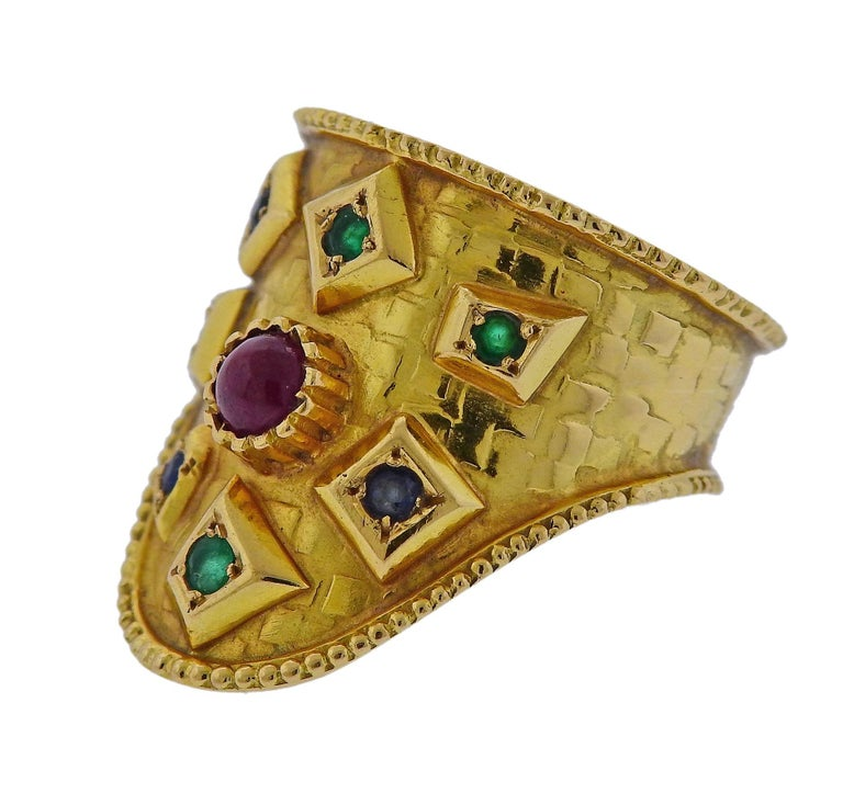 18k yellow gold ring, crafted by Green designer Ilias Lalaounis, set with emerald, ruby and sapphire gemstones.  Ring size - 7.25, ring top is 24mm wide and weighs 8 grams. Marked A21GR, 750, Lalaounis hallmark.