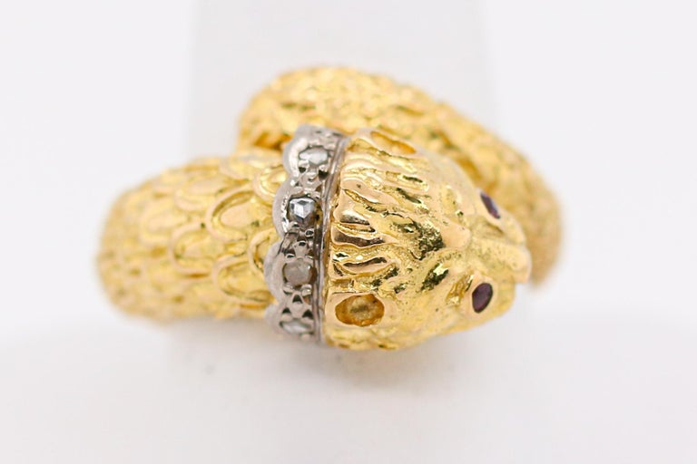 Incredible Ring from Renowned Greek Designer, Lalaounis.  This 18K yellow gold diamond ring with ruby eyes wraps around your finger like magic.