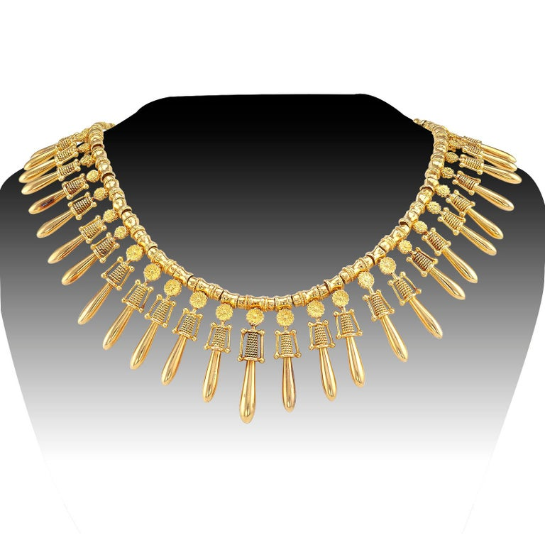 "Lalaounis archaeological revival style yellow gold fringe necklace circa 1970.  DETAILS:  METAL: 18-karat yellow gold. MEASUREMENTS: slightly graduated from 1-5/8"" (4.1 cm) to 1-1/8"" (2.9 cm), and 15"" (38.1 cm) long overall, 125 grams. SIGNED:"