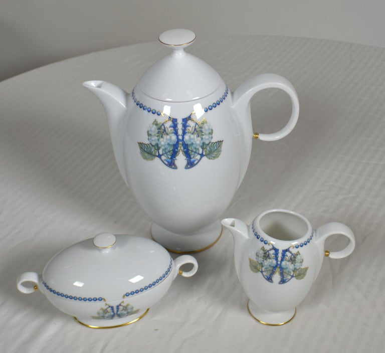 3-piece white, blue and multicolored Limoges porcelain Lalique Mûres Blackberry coffee set with beaded motif at rims, gilt accents throughout and brand stamp at undersides. Includes 1 coffee pot, 1 creamer and 1 sugar bowl. Made in France.