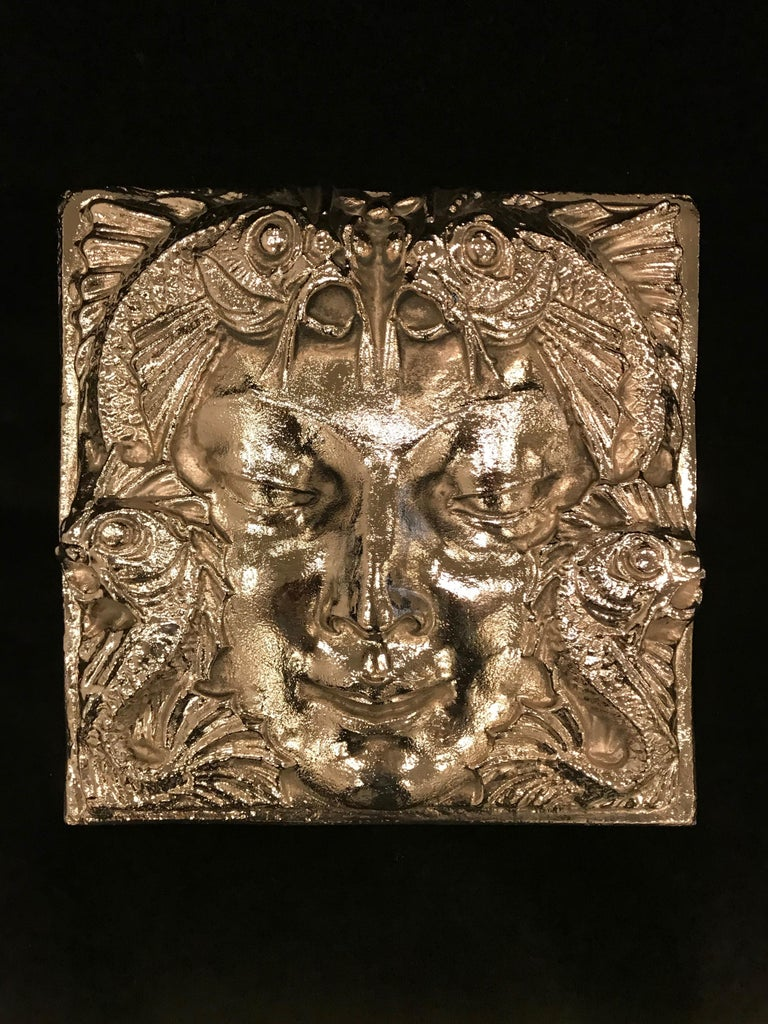 After a design by Lalique Masque de Femme hanging wall plaque. Features a beautiful woman's face with stylized dolphins in the Art Deco motif. Has been re plated in polished nickel over bronze. Ready for hanging. Adding the perfect touch to any
