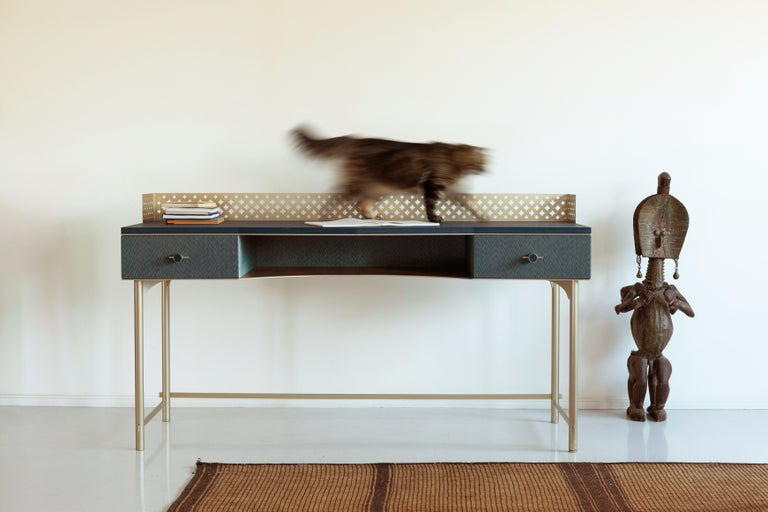 Wooden desk with fabric-effect wood. Two drawers with soft- close slides. Precision calibrated metal handles with wood insert. Laser-cut interlocking tubular structure in metal and laser-cut metal sheet with flower motifs finished manually. Metal