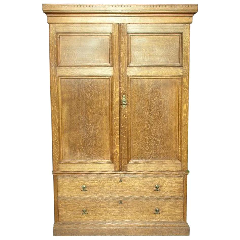 Lamb of Manchester, an Aesthetic Movement Compactum Armoire Wardrobe