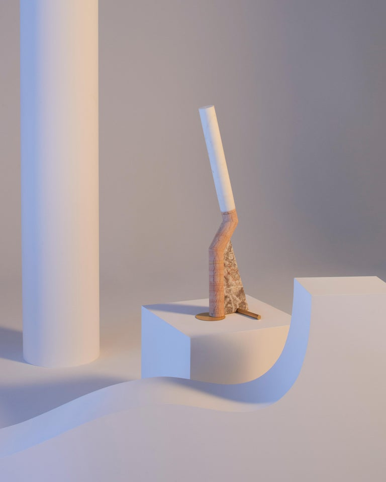 """Lightness and vitality. Bec Brittain's study of weights and proportions wasn't meant to be a pure sculptural exercise but, rather, aimed to make marble more her own, an everyday material. With its inner light, """"Heron"""" glides over the desk or table"""
