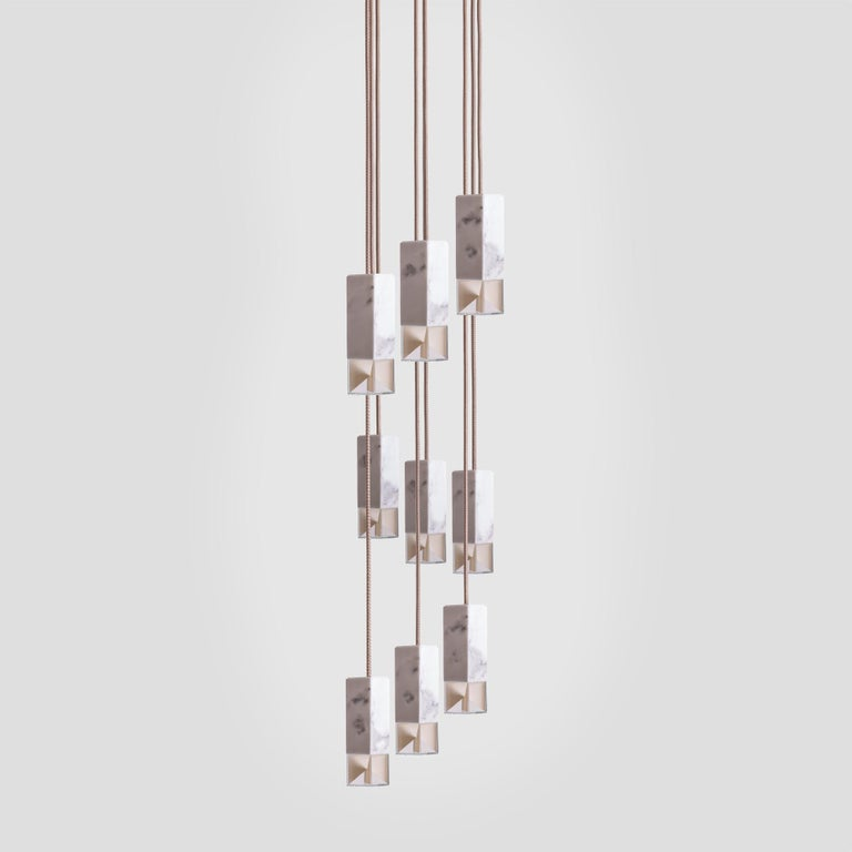 Inspired by midcentury designs, this superb chandelier is a statement piece that will add an elegant accent in a high-ceiling dining room or foyer. This piece showcases an architectural Silhouette composed of nine rectangular shades suspended at