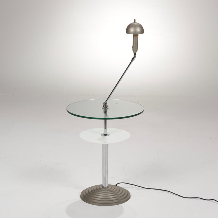 A amazing Memphis style lamp table by Daniela Puppa and Franco Raggi for Fontana Arte. Adjustable inclination stem, glass, opaline glass, metal. Model Altair 2755, Italy, 1988.  All items are viewable at our Los Angeles Arts District showroom and