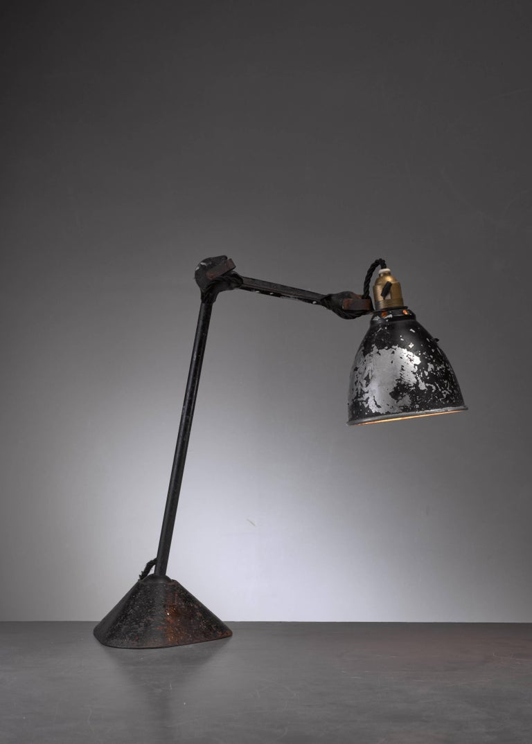 The iconic Lampe Gras model 205 table lamp was designed in 1921 by Bernard-Albin Gras and produced by Didier des Gachons & Ravel. The ball-joint connection in the foot allows you to position the stem in any desired angle.