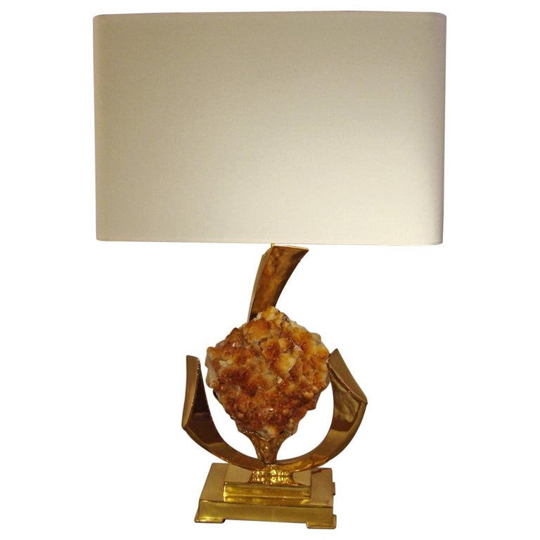 Lamp decorated with a golden rock crystal geode. For Sale