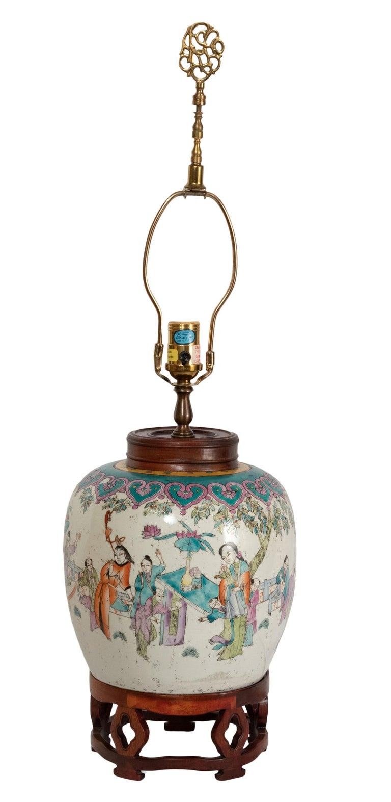 A lamped 19th century Qing dynasty famille rose peach vase with hardwood stand and cover.