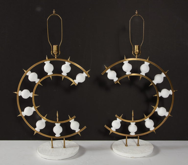 Decorative pair of plaster lamps designed by a local New York artist. The lamps are a combination of brass and white plaster. We have them in stock.