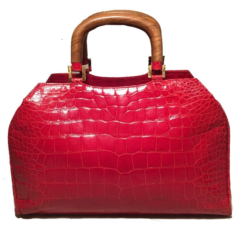Lana Marks Red Crocodile Wood Handle Handbag in excellent condition. Red crocodile skin exterior trimmed with gold hardware and two top wooden handles. Removable matching red crocodile shoulder strap easily converts between hand and shoulder bag