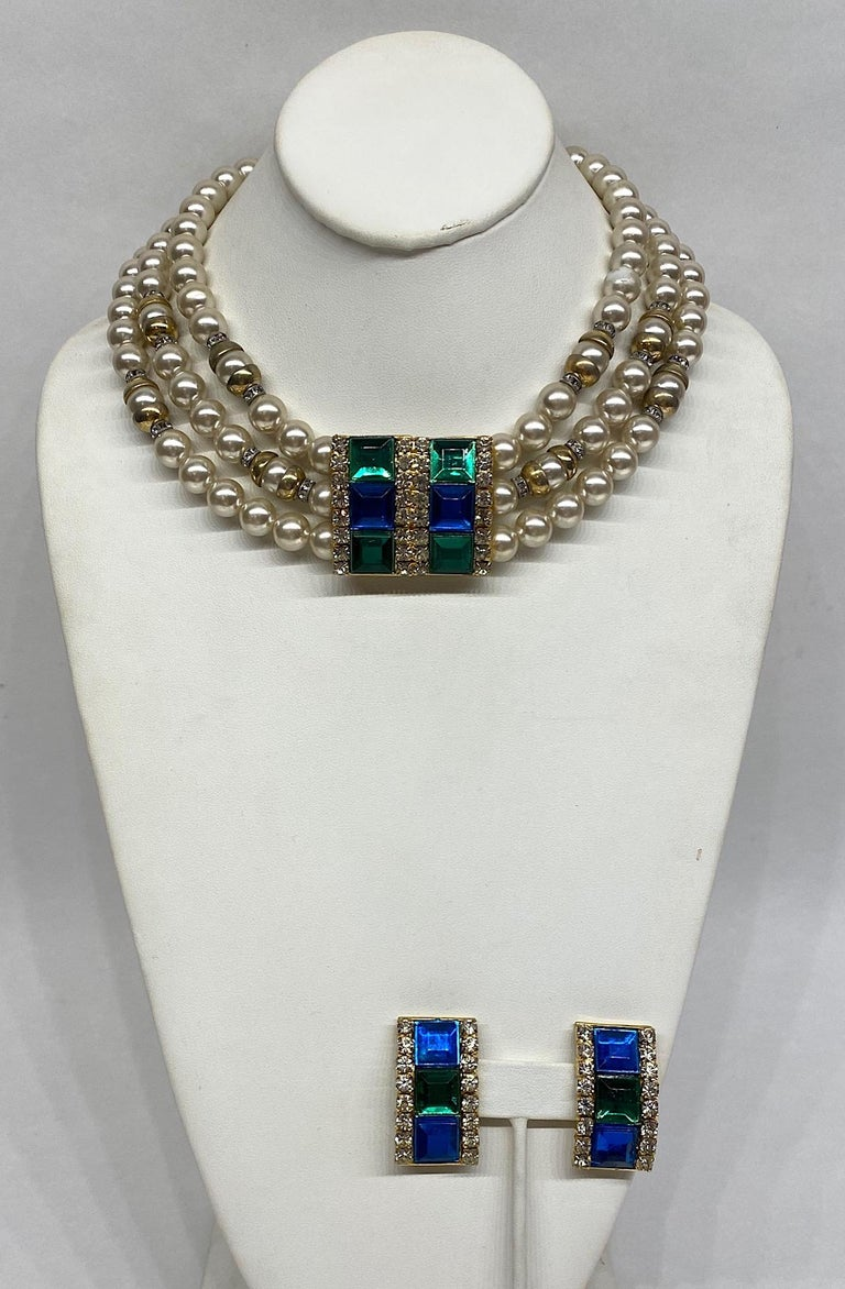 An elegant 1980s demi-parure of necklace with matching earrings by famous Italian fashion house Lancetti. The necklace is comprised of three strands of 10 mm glass pearls strung with rhinestone roundels and gold plate dome beads. The focal point of