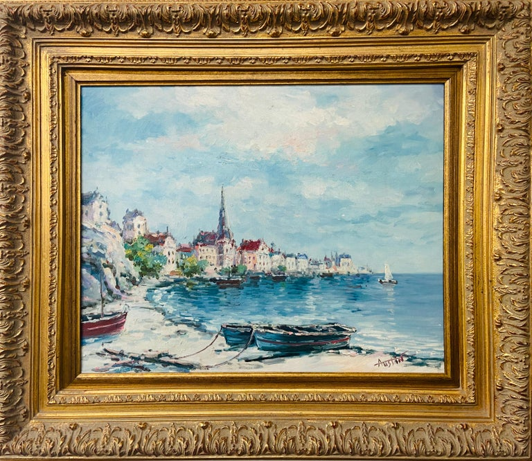 A stunning oil on canvas painting portraying a panoramic view of a town by the beach. The painting is finely framed in a decorative gilt frame and is signed by the artist Austin.   Dimensions: 28.25