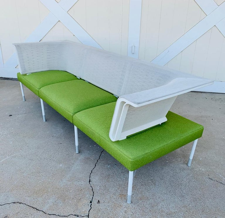 Designed by Yves Behar and manufactured by Herman Miller.  The landscape sofa is beautiful, great architectural lines, upholstered in a green fabric with a white mesh fabric on the back. Perfect for Indoors or outdoors.  Measurements:87 inches