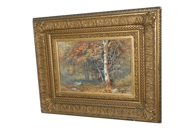 Beautifully painted landscape forest scene with stream in original giltwood frame, watercolor under glass. Signed in the lower right corner L. Douglas. American, early 20th century. Sight measures 13.5 inches wide x 9.5 inches high. Not viewed out