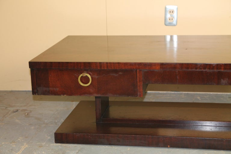 Great mahogany Cubist style coffee table from Lane with draw and brass pull. Marked Lane Altavista, VA in draw.