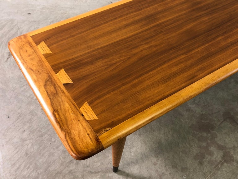 Vintage 1960s walnut and ashwood dovetailed coffee table by Lane Furniture Co. Newly refinished and in excellent condition. Marked underneath.