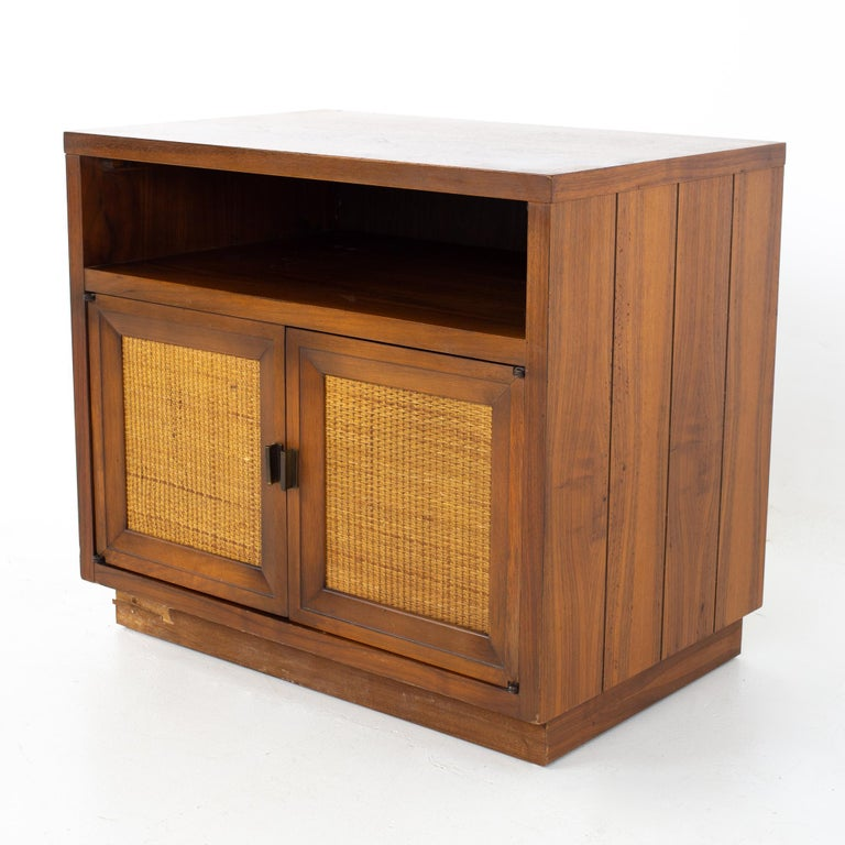 Lane mid century walnut and cane plinth base nightstand Nightstand measures: 26 wide x 17 deep x 23 inches high  All pieces of furniture can be had in what we call restored vintage condition. That means the piece is restored upon purchase so it's