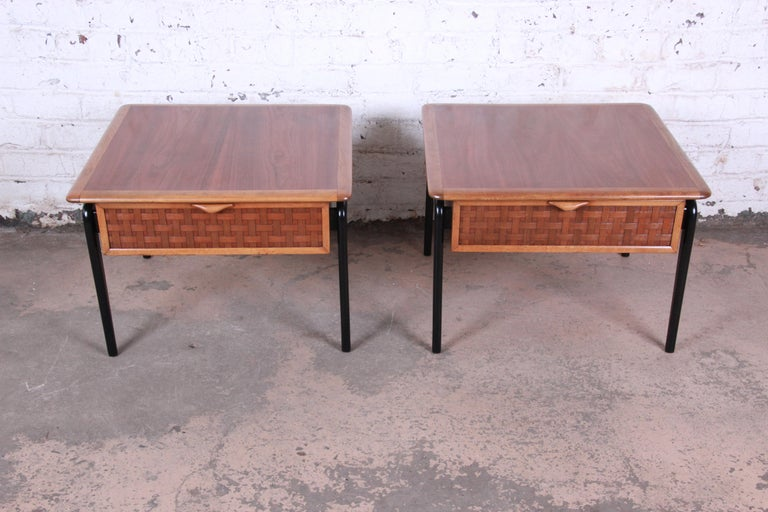 Offering a nice pair of lane perception walnut and black lacquer end tables designed by Warren Church. The tables have a nice walnut wood grain on the top with a large surface area. The legs have a nice black lacquer finish providing both style and