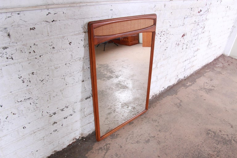 Lane Rhythm Mid-Century Modern Cane and Walnut Framed Mirror In Good Condition In South Bend, IN