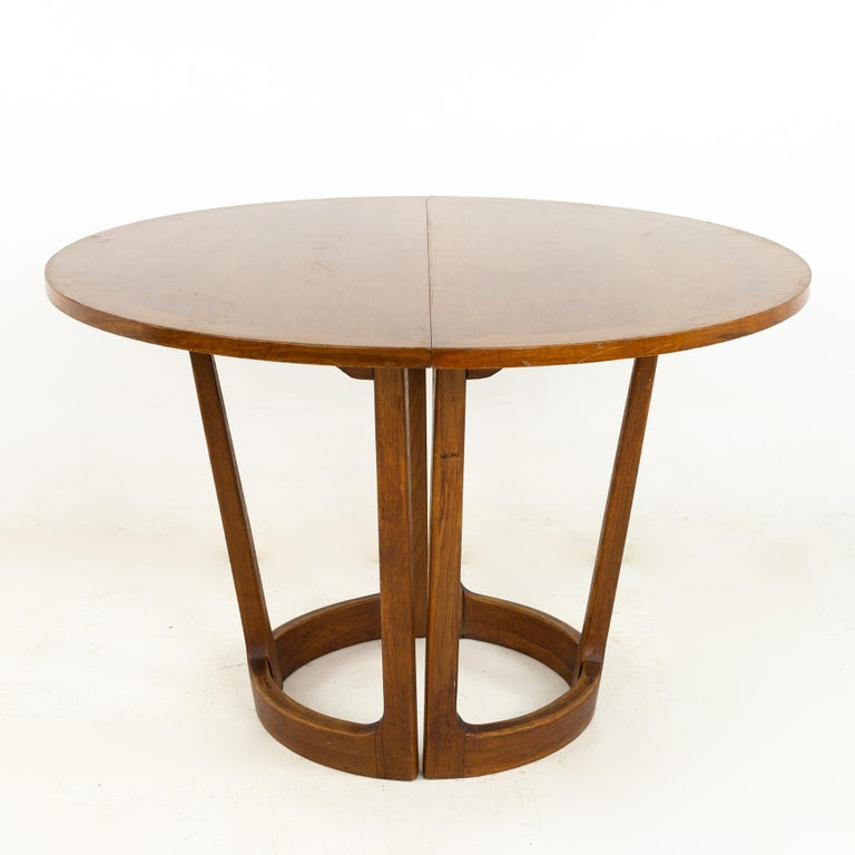 Lane Rhythm mid century round dining table  This table measures: 44 wide x 44 deep x 29 inches high, with a chair clearance of 28 inches; each leaf is 18 inches wide, making a maximum table width of 80 inches when both leaves are used  ?All