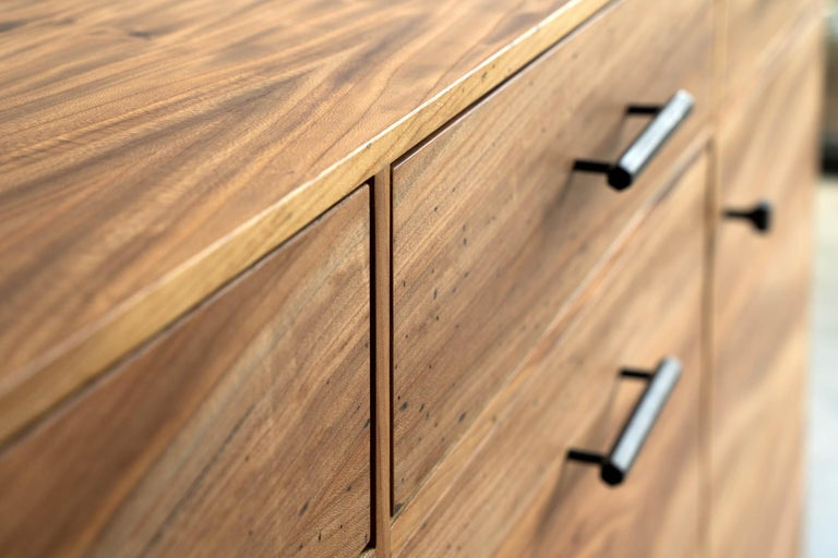 The Lanett Credenza in Elm by Alabama Sawyer is handcrafted and unique in every way. The elegance of the Lanett credenza strikes from the first moment with intricate veneer work showcasing the enigmatic grain patterns of urban timber. A