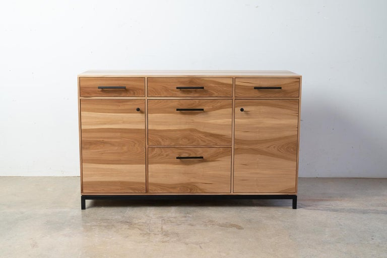 The Lanett Credenza in sweet gum by Alabama Sawyer is handcrafted and unique in every way. The elegance of the Lanett credenza strikes from the first moment with intricate veneer work showcasing the enigmatic grain patterns of urban timber. A