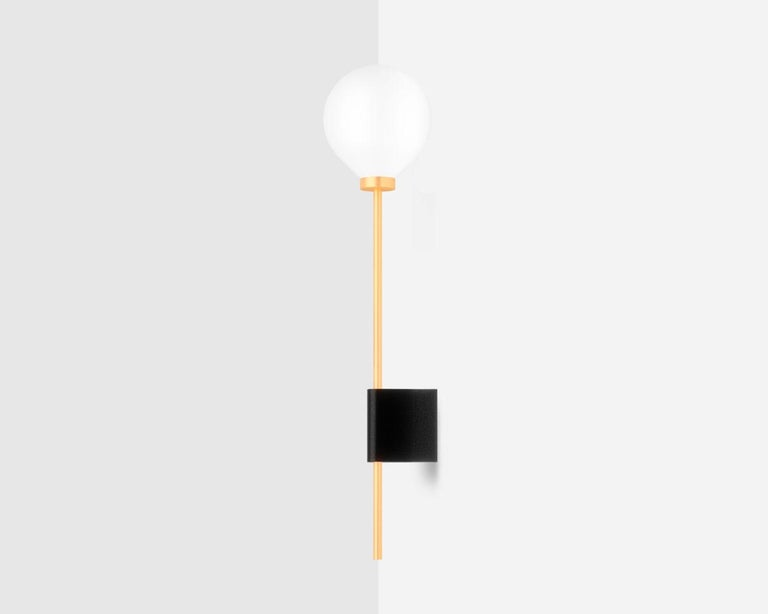 Lanta is a Minimalist sconce / wall lamp designed by Wishnya Design Studio. Brass.  Two finishes: white marble or black granite  Measures: 57 x 15 x 12.5 cm LED G4 35W 220V (dimmable) - US compatible.