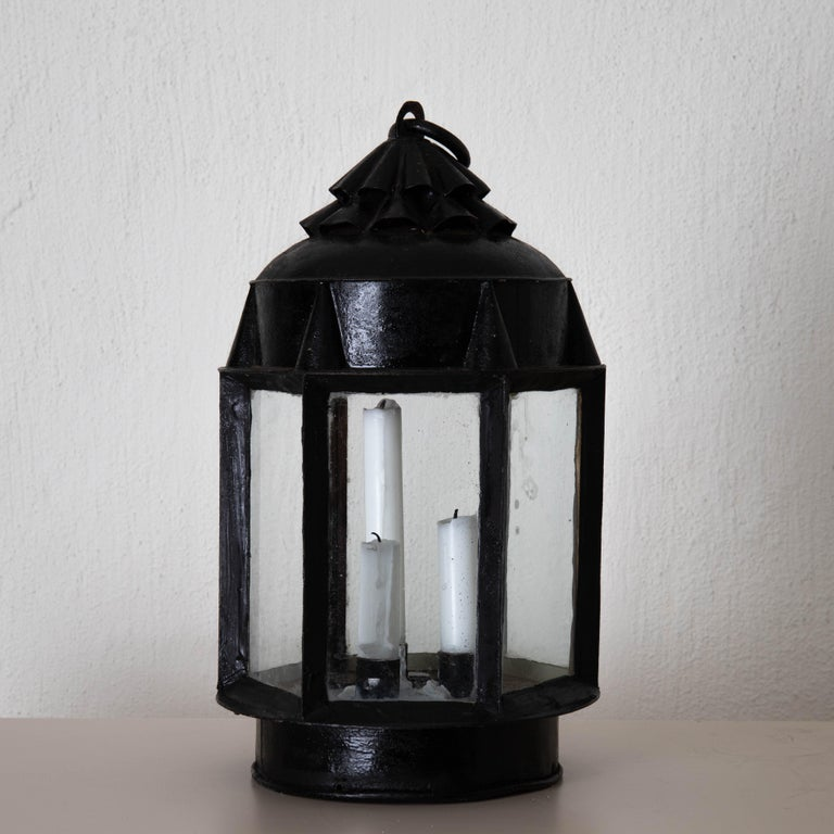 Lantern table Swedish 19th century black painted metal Sweden. A lantern made during the 19th century in Sweden. Made from painted metall. Candleholders for 3 candles.