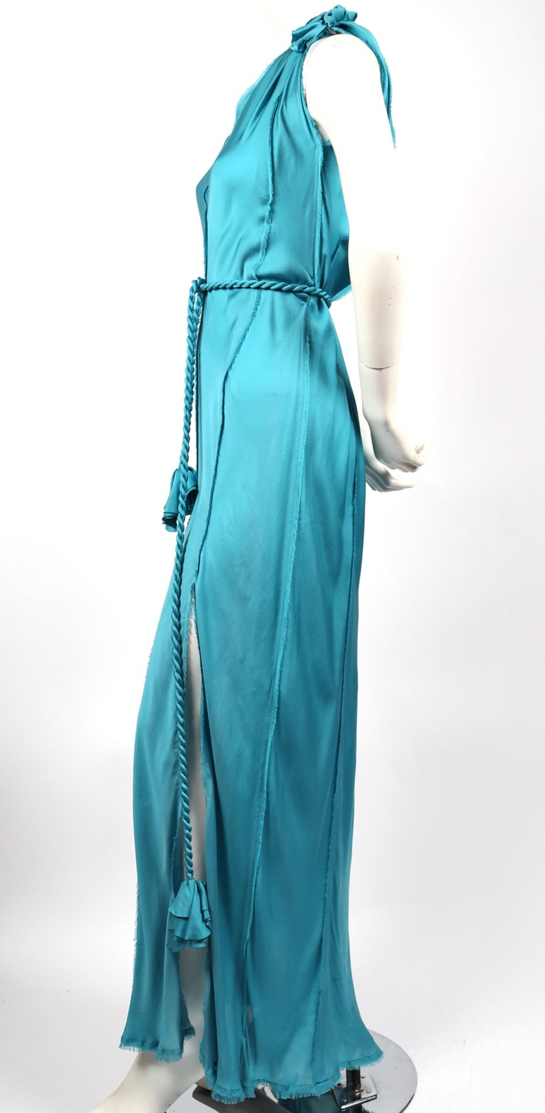 Turquoise silk, bias cut, dress with raw edges and twisted rope belt with rosettes designed by Alber Elbaz For Lanvin dating to spring of 2012. French size 36.  Measurements are very difficult to take due to the bias cut however approximate length