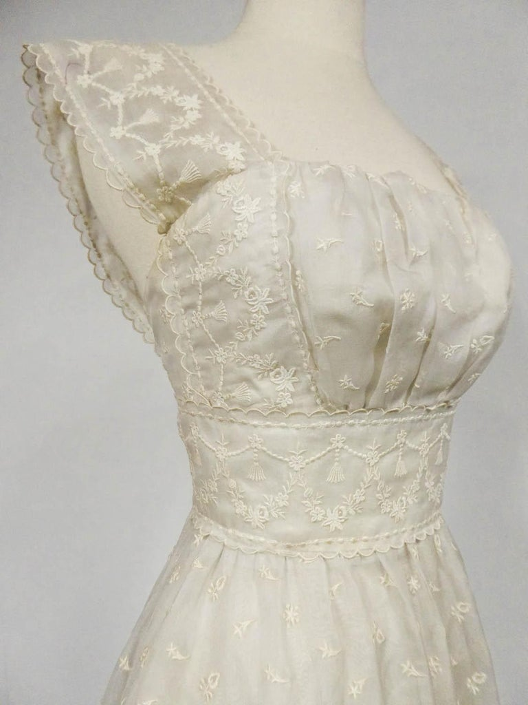 Circa 1957 France  Lanvin Castillo Haute couture ball gown (attributed to) in embroidered cream gazar from the late 1950s. High-waisted dress with square low-cut neckline underlined with gathers and a large matching waistband. Large straps covering