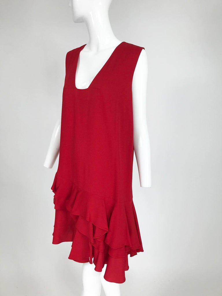 Lanvin cherry red silk blend crepe chemise dress, sleeveless with V square neckline, straight body with tiered ruffle hem. Pull on dress is lined at the upper bodice, the lower body is unlined. Reminiscent of the 1920s flapper era. Looks barely, if